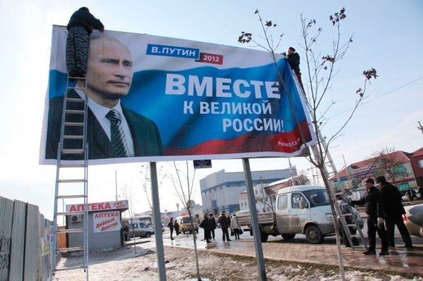 "Putin poster in Grozny, Chechnya. It reads ""To great Russia - together."""