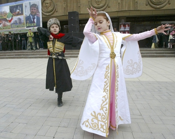Children dressed in national costumes dance in central Grozny during celebrations of the lifting of security regime