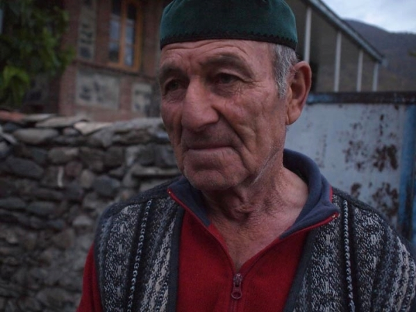 An effusive Chechen elder I met at sundown in the village of Birkiani where I stayed in 2002. What a cool guy! A random Westerner shows up at his gate and he immediately offers warm, old school Chechen hospitality. ©2013 Derek Henry Flood