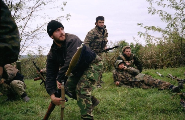 Chechen rebels during a Russian helicopter attack near Goragorsk, during Russia's second war in Chechnya. October 1999