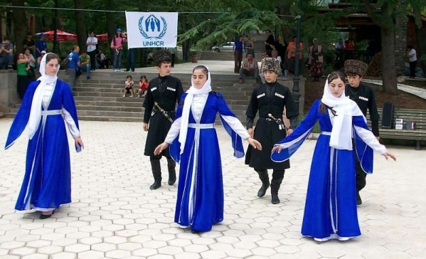 Chechen refugee children from the Pankisi Valley perform a traditional dance to celebrate World Refugee day in Mtatsminda Amusement Park, in Tbilisi, Georgia