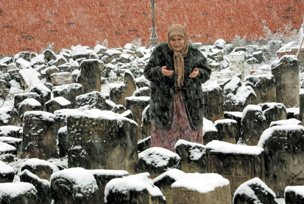 Chechen woman in Grozny cemetery Chechnya Russia war North Caucasus