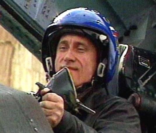 Vladimir Putin flying a jet in Chechnya