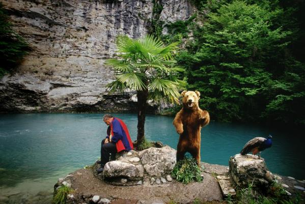 With its lush Black Sea location, Abkhazia is trying to attract Russian tourists. Here, at a road stop on the tour bus route, an entrepreneur, who charges tourists 10 rubles to photograph his bear, catches his breath between busloads.