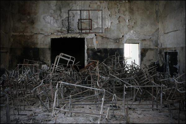 Burnt school in one of the Georgian enclaves. South Ossetia, 2009