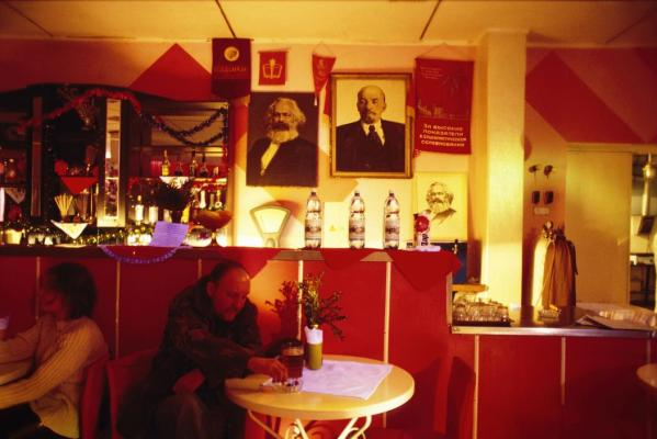 "Patrons of ""Red Heat"", a local bar, drinking under banners with the Soviet hammer & sickle. In Transdniester, nostalgia for the USSR runs very high."