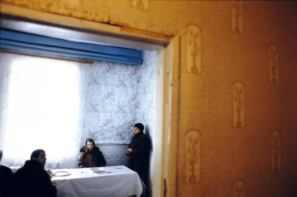 People attending a church-run soup kitchen. Most Transdniestrians are poor, and a large portion of the population are pensioneers longing for the better times of the USSR.