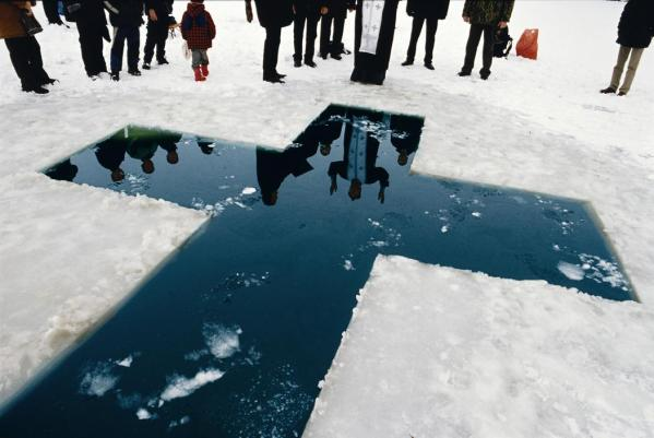 The population of Transdniester is mainly ethnic Russians, and the main religion is Russian Orthodox Christianity. Here a priest gives his blessings before a christening in the icy waters of January.